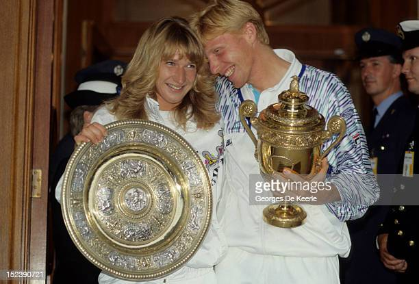 German tennis players Steffi Graf and Boris Becker with their trophies after their wins in the Women's and Men's Singles at Wimbledon on July 9 1989