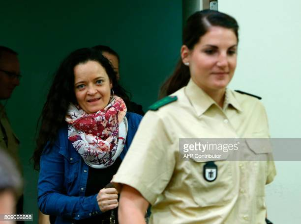German terror suspect Beate Zschaepe accused of helping to found a neoNazi cell the National Socialist Underground arrives for the continuation of...
