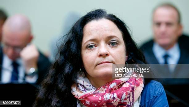 German terror suspect Beate Zschaepe accused of helping to found a neoNazi cell the National Socialist Underground waits for the continuation of her...