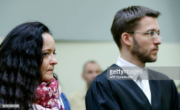 German terror suspect Beate Zschaepe accused of helping to found a neoNazi cell the National Socialist Underground sits next to her lawyer Mathias...