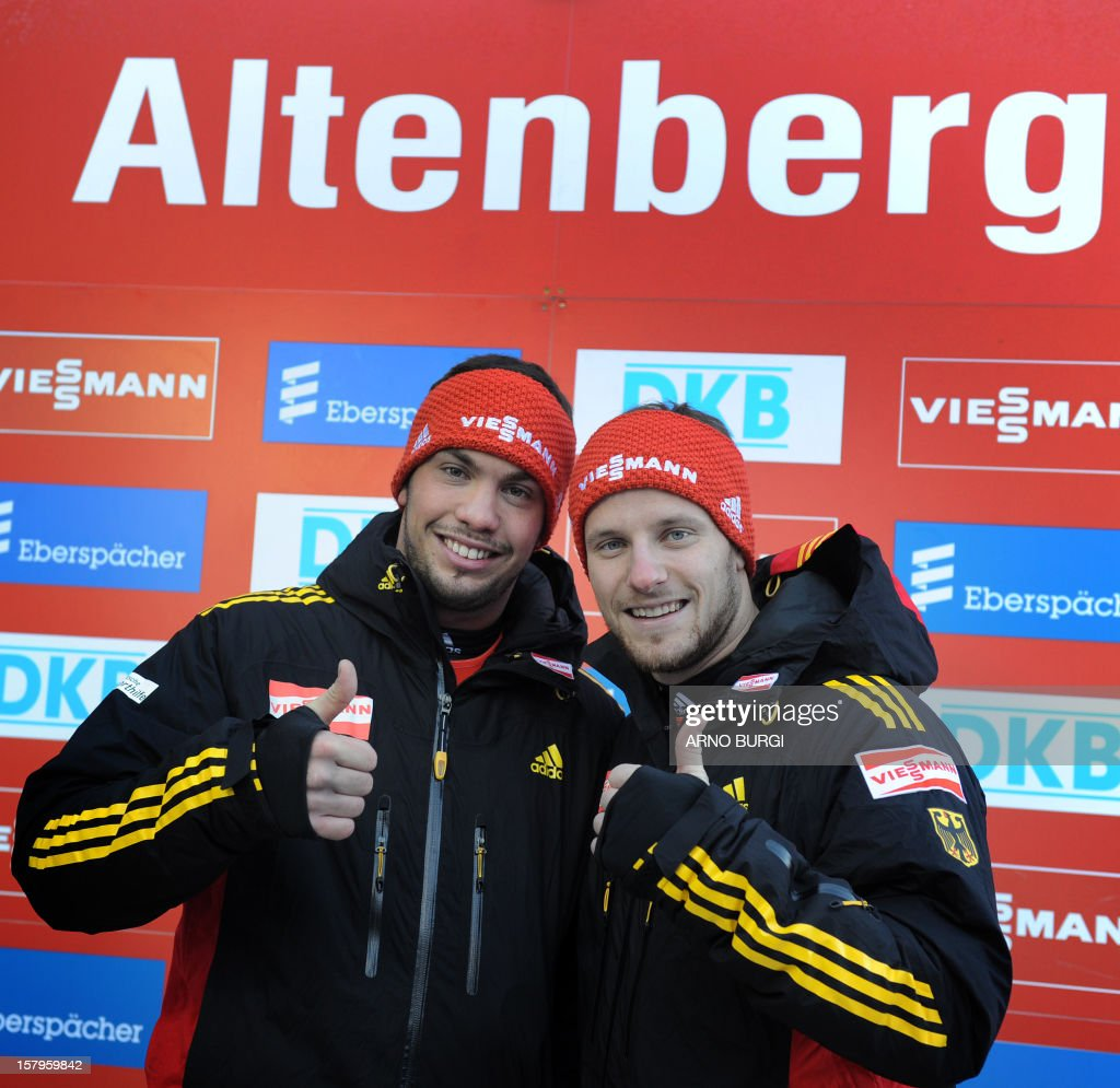 German <a gi-track='captionPersonalityLinkClicked' href=/galleries/search?phrase=Tobias+Wendl&family=editorial&specificpeople=4784289 ng-click='$event.stopPropagation()'>Tobias Wendl</a> (L) and <a gi-track='captionPersonalityLinkClicked' href=/galleries/search?phrase=Tobias+Arlt&family=editorial&specificpeople=4784288 ng-click='$event.stopPropagation()'>Tobias Arlt</a> pose for photographers after winning the Viessmann double Luge World Cup series in Altenberg, eastern Germany on December 8, 2012. Wendl and Arlt placed first.