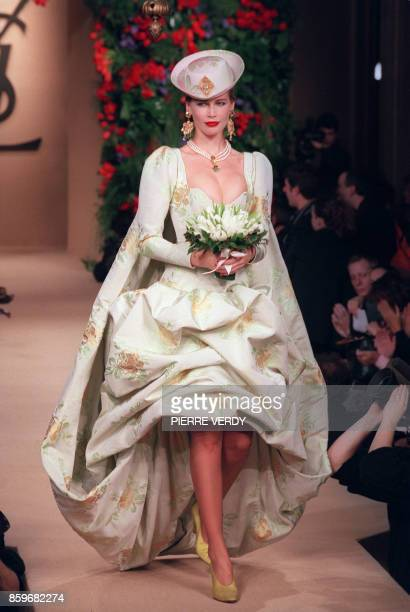 German top model Claudia Schiffer displays the wedding gown 22 January 1997 in Paris as part of Yves Saint Laurent 's springsummer haute couture...