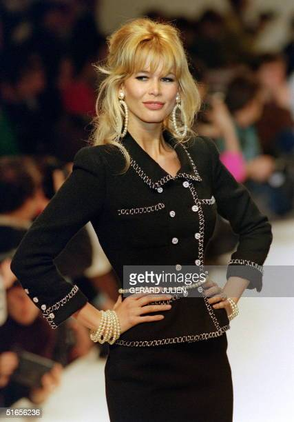German topmodel Claudia Schiffer displays 24 January 1995 in Paris a black tweed suit embroidered with a white and black braid designed by Karl...