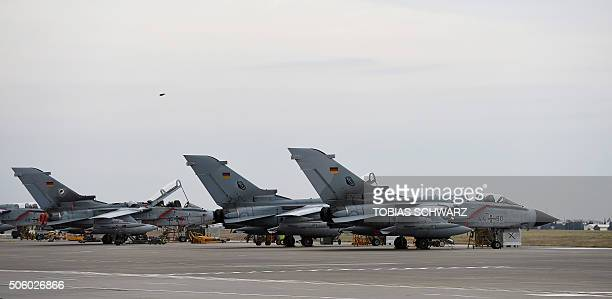 German Tornado jets are pictured on the groung at the air base in Incirlik Turkey on January 21 2016 / AFP / POOL / TOBIAS SCHWARZ