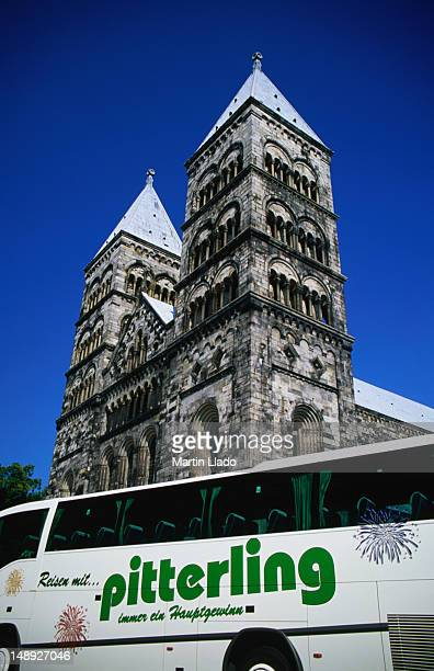German tourist bus parked in front of Lund Domkyrka (Cathedral).