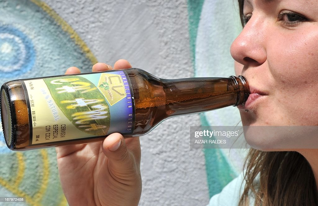 S German tourist drinks Ch'ama, a coca leaves and barley based beer in a bar in La Paz, on May 2, 2013. The beer, made with organic barley and coca, have the same alcohol content that a normal one, and is mainly consumed by European tourists. AFP PHOTO / Aizar Raldes