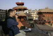 German tourist shoots video of the historical Durbar Square January 27 2006 in Kathmandu Nepal Nepal continues to loose tourist dollars because of...