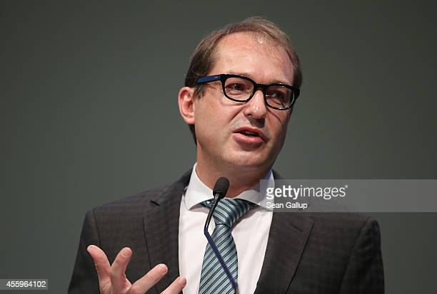 German Transport and Digital Technologies Minister Alexander Dobrindt speaks at the annual congress of the German Federation of Industry on September...