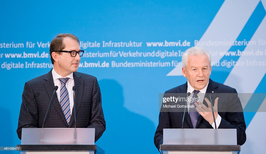 German Transport Minister <a gi-track='captionPersonalityLinkClicked' href=/galleries/search?phrase=Alexander+Dobrindt&family=editorial&specificpeople=5702301 ng-click='$event.stopPropagation()'>Alexander Dobrindt</a> and CEO of Deutsche Bahn AG, Ruediger Grube (R) attend the signing ceremony of Service and Financing Agreement II on January 12, 2015 in Berlin, Germany.