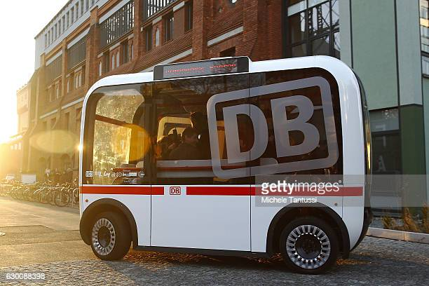 German Transport Minister Alexander Dobrindt and Deutsche Bahn head Ruediger Grube sit in a self driving Bus during the presentation of a pilot...