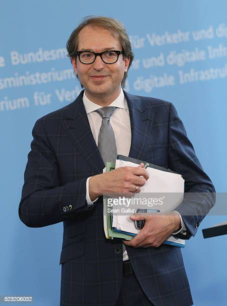 German Transport Minister Alexander Dobrindt departs after speaking to the media to annouce the findings of a commission that investigated the...