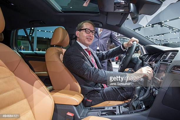 German Transport Minister Alexander Dobrindt sit on a VW Golf Edition at the VW Golf GTE at the 2014 AMI Auto Show on May 30 2014 in Leipzig Germany...