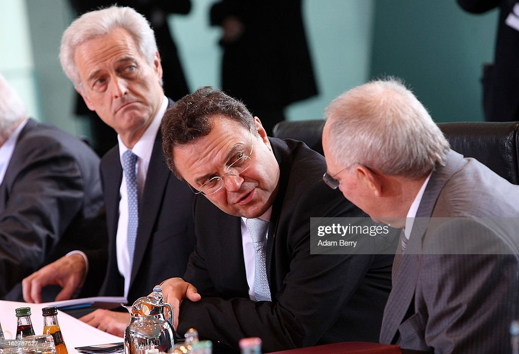 German Transport Minister Peter Ramsauer, German Interior Minister Hans-Peter Friedrich, and German Finance Minister Wolfgang Schaeuble speak to one another as they arrive for the weekly German federal cabinet meeting on February 27, 2013 in Berlin, Germany. High on the morning's agenda was discussion of the country's annual report on disarmament as well as of potential modifications to a law on employment rights for foreigners.