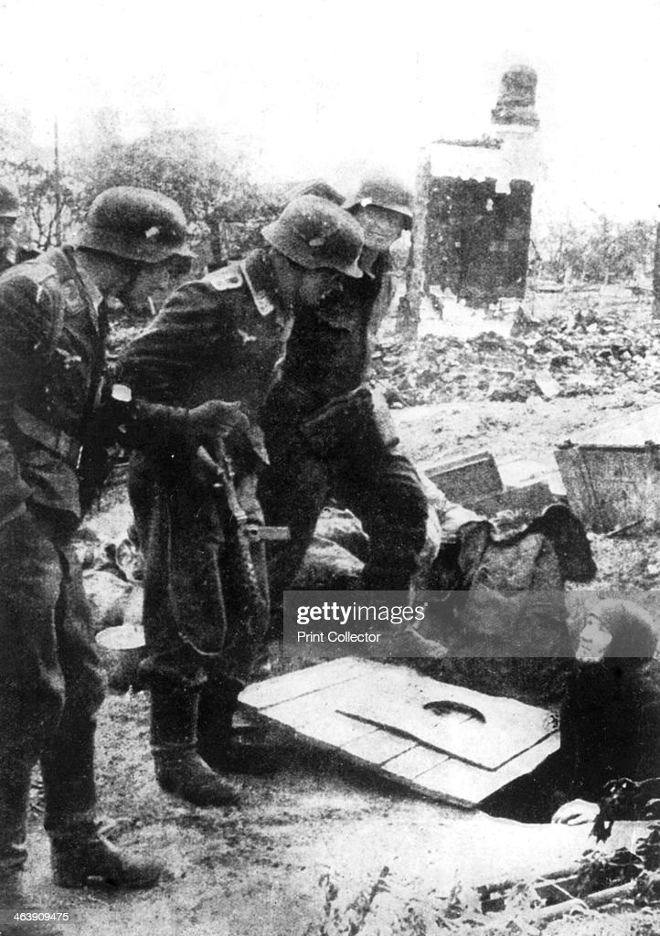German troops entering Stalingrad Russia September 1942 An elderly Russian woman emerges from a cellar in the shattered ruins of the city Fought...