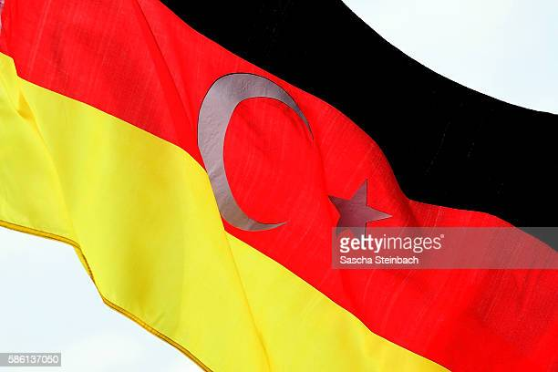 German Turkish flag is seen while supporters of Turkish President Recep Tayyip Erdogan rally at a gathering on July 31 2016 in Cologne Germany...