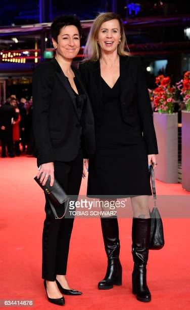 German TV host Dunja Hayali and Pamela Schobess arrive for the opening of the Berlinale film festival with the premiere of 'Django' during the 67th...