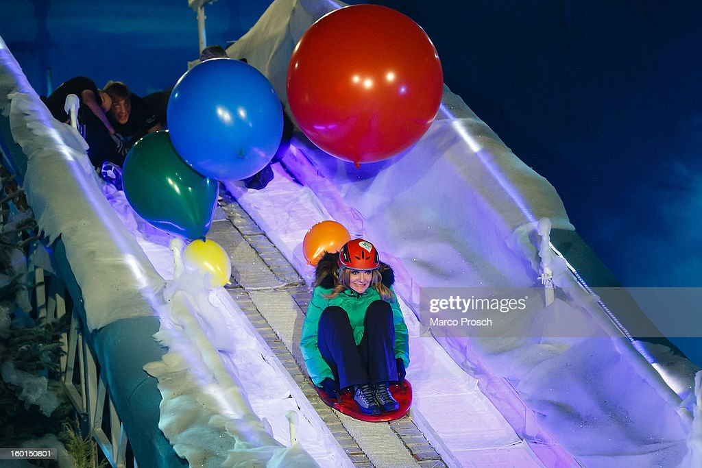 German TV presenter Bettina Tietjen jumps off a ski jump during the 'Winterfest der fliegenden Stars' TV-Show on January 26, 2013 at the Freiheitshalle in in Hof, Germany.