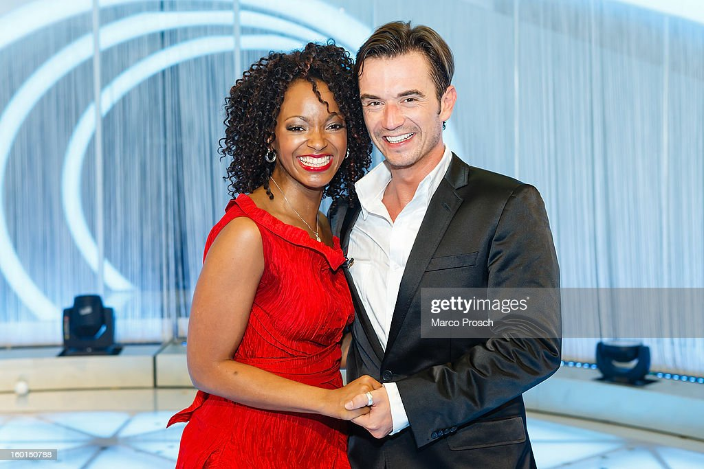 German TV presenter <a gi-track='captionPersonalityLinkClicked' href=/galleries/search?phrase=Florian+Silbereisen&family=editorial&specificpeople=2919730 ng-click='$event.stopPropagation()'>Florian Silbereisen</a> (L) and musical singer Zodwa Selele (R) pose for pictures after the 'Winterfest der fliegenden Stars' TV-Show on January 26, 2013 at the Freiheitshalle in in Hof, Germany.