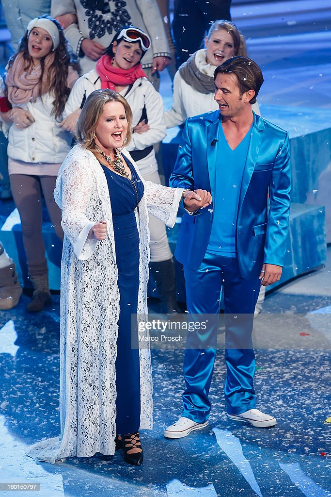 German TV presenter <a gi-track='captionPersonalityLinkClicked' href=/galleries/search?phrase=Florian+Silbereisen&family=editorial&specificpeople=2919730 ng-click='$event.stopPropagation()'>Florian Silbereisen</a> (R) and Norwegian singer Anita Hegerland (L) perform on stage during the 'Winterfest der fliegenden Stars' TV-Show on January 26, 2013 at the Freiheitshalle in in Hof, Germany.