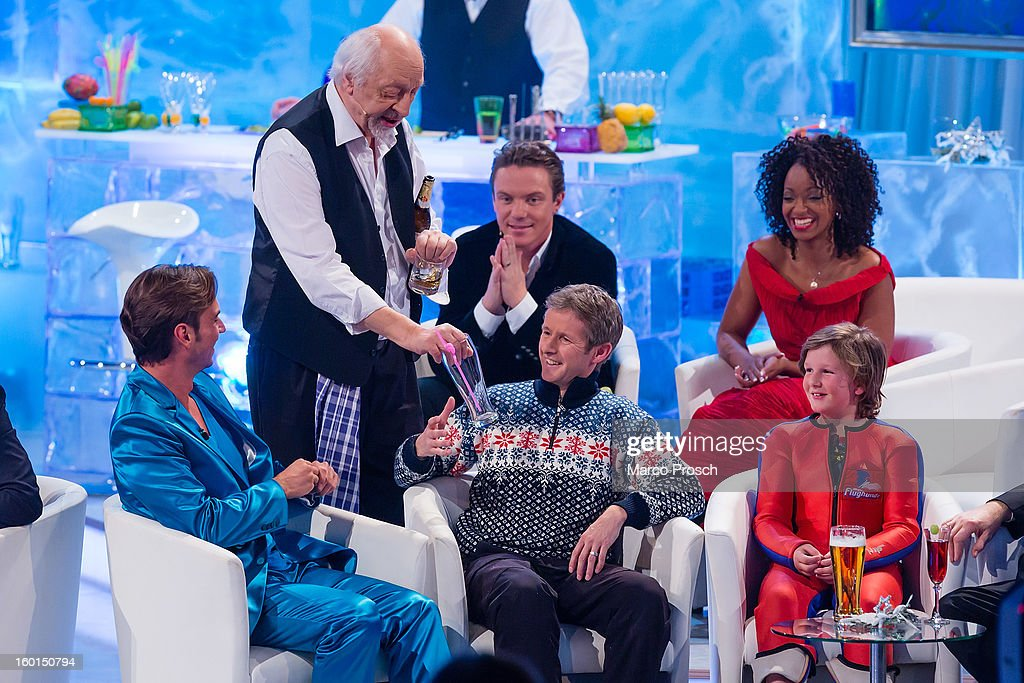 German TV presenter <a gi-track='captionPersonalityLinkClicked' href=/galleries/search?phrase=Florian+Silbereisen&family=editorial&specificpeople=2919730 ng-click='$event.stopPropagation()'>Florian Silbereisen</a>, comedian Karl Dall, Stefan Mross, Jens Weissflog, Zodwa Selele and Florian Ritzer appear on the 'Winterfest der fliegenden Stars' TV-Show on January 26, 2013 at the Freiheitshalle in in Hof, Germany.