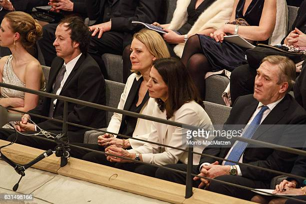 German TVhost Anne Will and her wife Miriam Meckelas listen to a speech as they attend the opening concert of the Elbphilharmonie concert hall on...