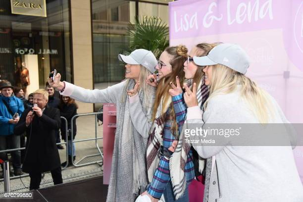 German twins Lisa and Lena M and fans are seen during a meet greet on April 19 2017 in Berlin Germany