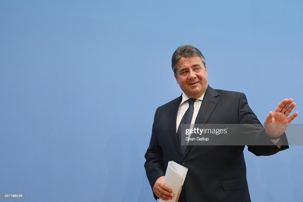 German Vice Chancellor and Economy and Energy Minister Sigmar Gabriel departs after presenting the German government's revised economic outlook on October 14, 2014 in Berlin, Germany. Gabriel announced the government has downgraded its growth forecast for German gross domestic product (GDP) in 2014 from 1.8% to 1.2%. The revision follows a drop in factory orders and industrial output in August.