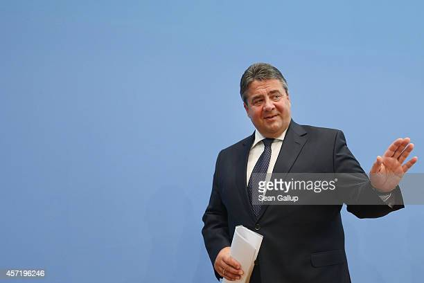 German Vice Chancellor and Economy and Energy Minister Sigmar Gabriel departs after presenting the German government's revised economic outlook on...