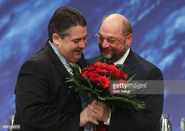 German Vice Chancellor and Economy and Energy Minister Sigmar Gabriel who is also Chariman of the German Social Democrats congratulates Martin Schulz...