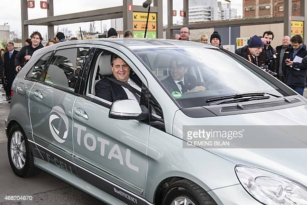 German Vice Chancellor and Economy and Energy Minister Sigmar Gabriel and French Economy and Industry Minister Emmanuel Macron take a test drive with...