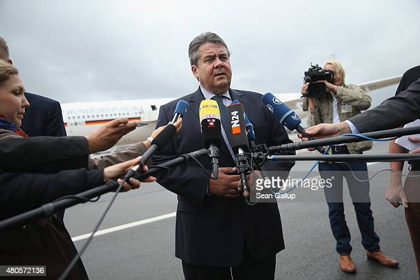 German Vice Chancellor and Economy and Energy Minister Sigmar Gabriel speaks to the media about the justpassed Greece aid package before boarding a...