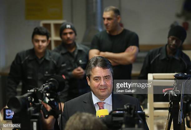 German Vice Chancellor and Economy and Energy Minister Sigmar Gabriel speaks to the media as asylumapplicants from Syria Kosovo Lebanon and Gambia...