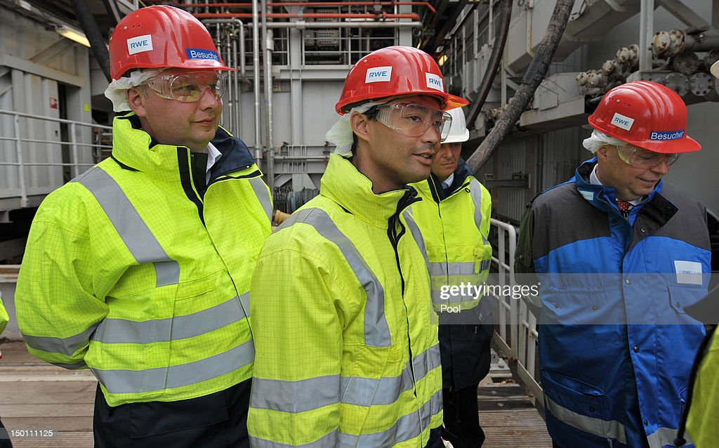 German Vice Chancellor and Economy Minister Philipp Roesler (C) and Lower Saxony Economy Minister Joerg Bode (L) and RWE-Vorstandsvorsitzender Peter Terium (R) visit the 'Mittelplate' oil drilling platform while visiting it by ship in the North Sea on August 10, 2012 near Cuxhaven, Germany. Roesler is visiting the platform, which is operated by RWE DEA AG, in order to get a first-hand impression of Germany's oil and gas resources, which he says are critical for maintaining affordable energy for German consumers. Germany is pursuing an aggressive policy toward increasing its production of electricity from renewable resources, especially solar and wind, though traditional energy sources such as gas, oil and coal will remain vital, especially in the medium term.
