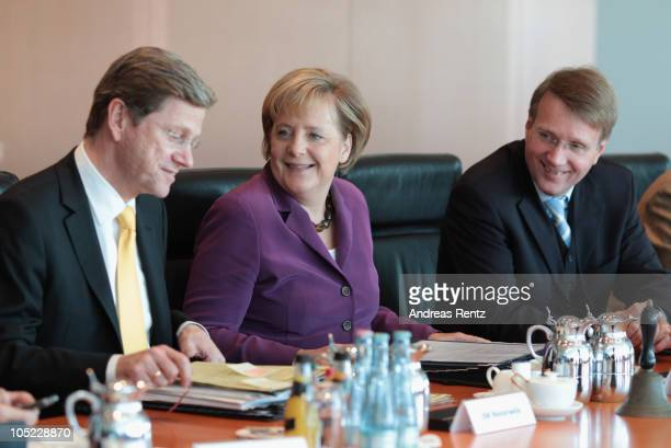 German Vice Chancellor and Foreign Minister Guido Westerwelle German Chancellor Angela Merkel and Minister of the Chancellery Ronald Pofalla attend...