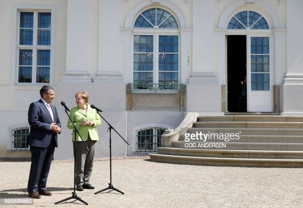 German Vice Chancellor and Foreign Minister Sigmar Gabriel and German Chancellor Angela Merkel deliver a speech during 'Future Talks' meeting with...