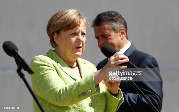 German Vice Chancellor and Foreign Minister Sigmar Gabriel and German Chancellor Angela Merkel arrive to deliver a speech during 'Future Talks'...