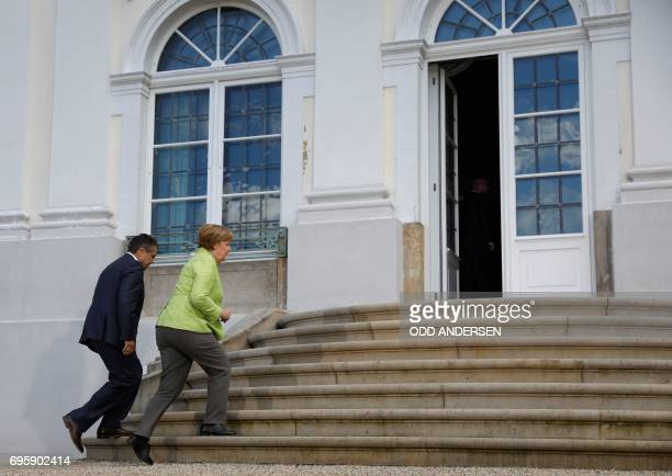 German Vice Chancellor and Foreign Minister Sigmar Gabriel and German Chancellor Angela Merkel enter the Meseberg Palace during 'Future Talks'...