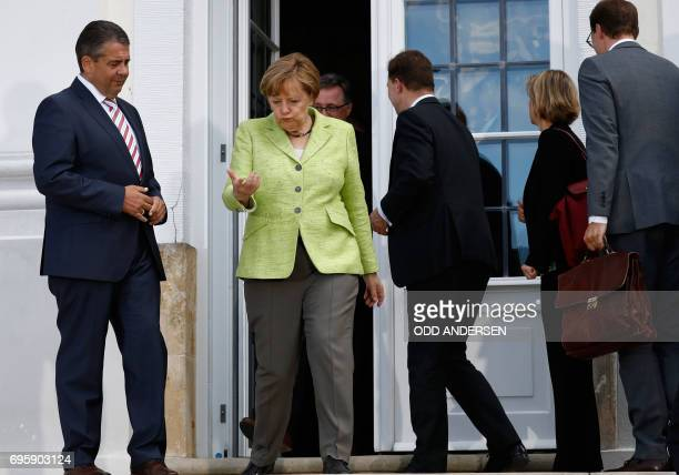 German Vice Chancellor and Foreign Minister Sigmar Gabriel and German Chancellor Angela Merkel talk during 'Future Talks' meeting with social...
