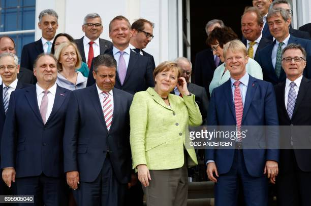 German Vice Chancellor and Foreign Minister Sigmar Gabriel and German Chancellor Angela MerkelReiner Hoffmann chairman of the German trade union...