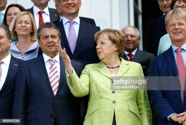 German Vice Chancellor and Foreign Minister Sigmar Gabriel and German Chancellor Angela Merkel pose for a family photo during 'Future Talks' meeting...