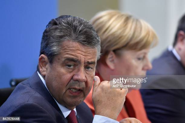 German Vice Chancellor and Foreign Minister Sigmar Gabriel and German Chancellor Angela Merkel attend a press conference after a meeting with the...