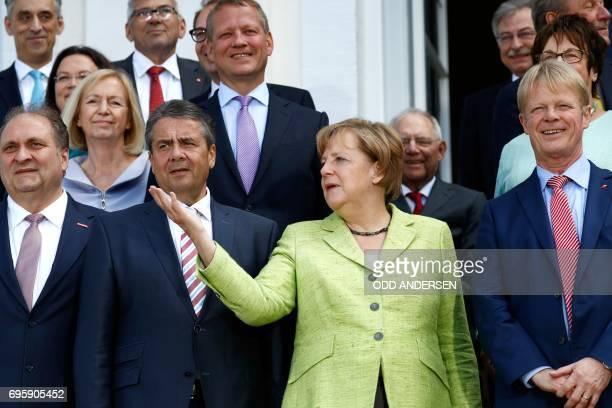 German Vice Chancellor and Foreign Minister Sigmar Gabriel German Chancellor Angela Merkel Reiner Hoffmann chairman of the German trade union...