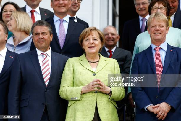 German Vice Chancellor and Foreign Minister Sigmar Gabriel L German Chancellor Angela Merkel and Reiner Hoffmann chairman of the German trade union...