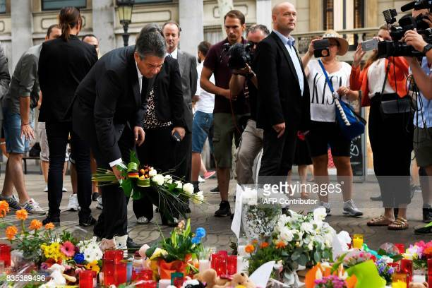 German Vice Chancellor and Foreign Minister Sigmar Gabriel lays a wreath of flowers for victims of the Barcelona attack at the Fuente de Canaletas in...