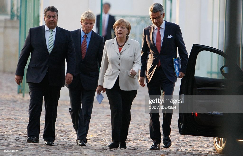 German Vice Chancellor Economy and Energy Minister Sigmar Gabriel Chairman of the Confederation of German Trade Unions Reiner Hoffmann German...
