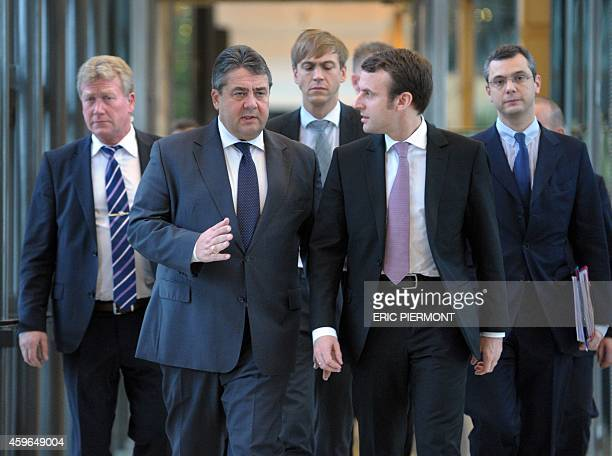 German ViceChancellor and Economy and Energy Minister Sigmar Gabriel and French Economy Minister Emmanuel Macron arrive to attend a press conference...
