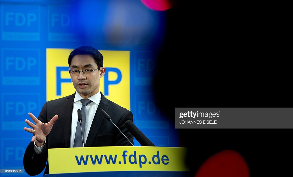 German Vice-Chancellor and Economy Minister Philipp Roesler, chairman of the free democratic FDP party, holds a press conference on March 18, 2013 in Berlin. He pointed out his party's position against a possible attempt to ban the country's right extremist NPD party.