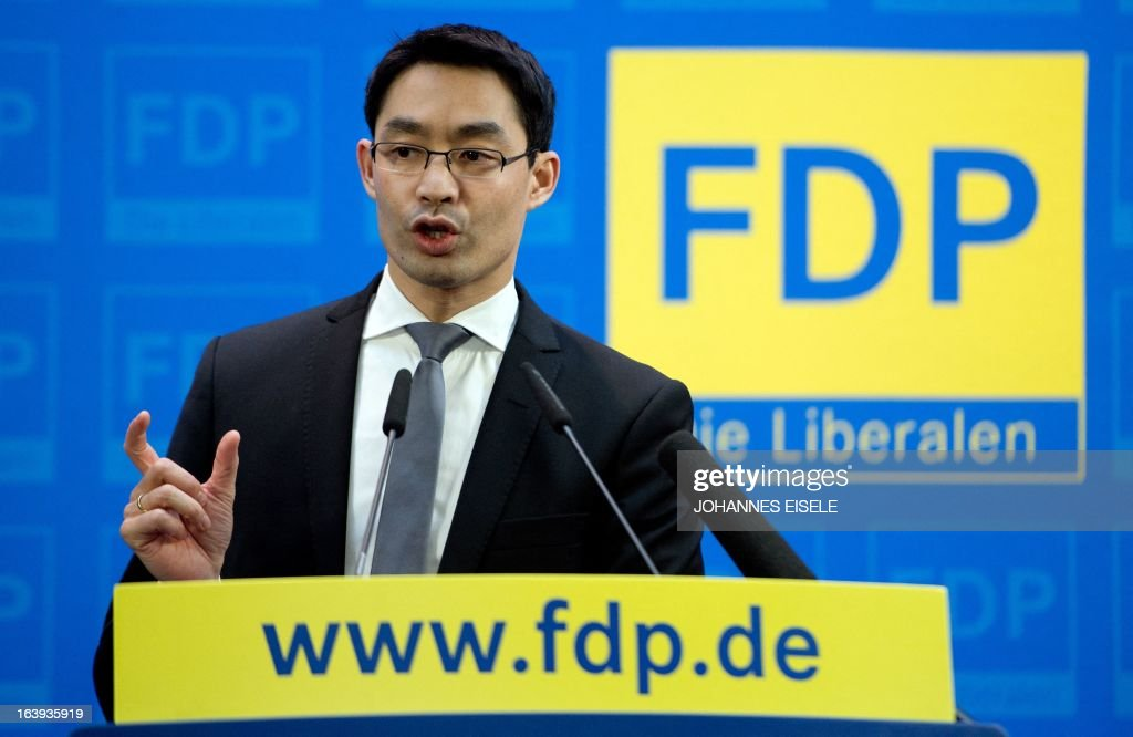 German Vice-Chancellor and Economy Minister Philipp Roesler, chairman of the free democratic FDP party, holds a press conference on March 18, 2013 in Berlin. He pointed out his party's position against a possible attempt to ban the country's right extremist NPD party. AFP PHOTO / JOHANNES EISELE