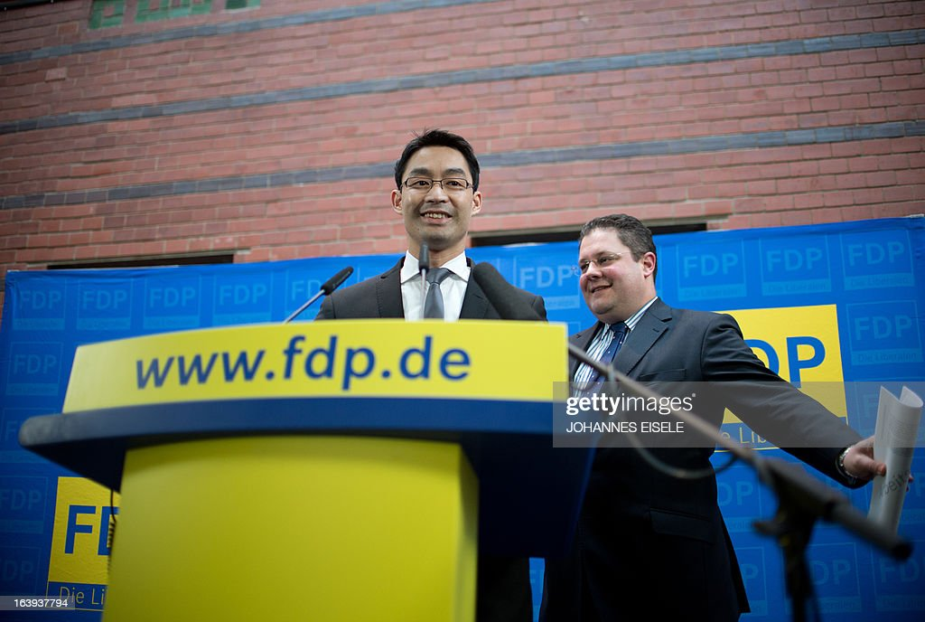 German Vice-Chancellor and Economy Minister Philipp Roesler (L), chairman of the free democratic FDP party, and FDP secretary general Patrick Doering hold a press conference on March 18, 2013 in Berlin. They pointed out their party's position against a possible attempt to ban the country's right extremist NPD party.