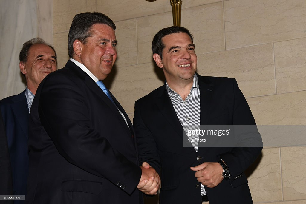 German Vice-Chancellor and Minister of Economy <a gi-track='captionPersonalityLinkClicked' href=/galleries/search?phrase=Sigmar+Gabriel&family=editorial&specificpeople=543927 ng-click='$event.stopPropagation()'>Sigmar Gabriel</a> visits the Greek Prime Minister <a gi-track='captionPersonalityLinkClicked' href=/galleries/search?phrase=Alexis+Tsipras&family=editorial&specificpeople=6592450 ng-click='$event.stopPropagation()'>Alexis Tsipras</a> in his office Maximos Mansion in Athens, on June 30., 2016